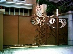by DecoDesignCenter.com  Custom-made wrought iron sliding gate solid with semi scrollwork.