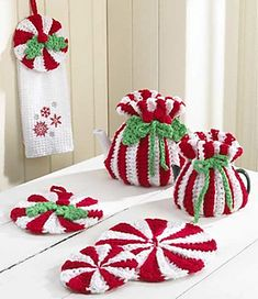 Enjoy a refreshing Wintermint Wonderland with this delicious Peppermint Kitchen Set. Liven up your winter months with these seasonal colors. Revel in this charming set while you sit by the fire sipping hot tea on a cold, blustery day or delight your friends during a luncheon. Towel topper and Potholder look like peppermint candies that are decorated with holly leaves and berries while Hot Pad and Coaster each resemble a giant peppermint candy. Both Large and Small Tea Cozy are adorned with…