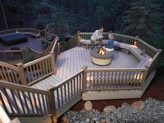 Designer Decks  Multi Levels and Purposes  To take full advantage of the hillside, this composite deck was designed with multiple tiers, each one with a different purpose. The lower tier has a hot tub, while just above it is a fire pit and built-in benches. Photo by TimberTech.