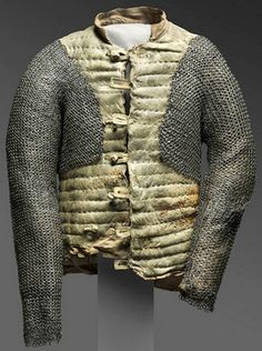 European arming doublet, 1550-1650, repaired c. 1937 by Leonard Heinrich. Leather, linen, flax fiber, steel, and brass. Center Back Length: 25 1/4 inches (64.1 cm) Waist: 36 1/2 inches (92.7 cm) 9 lb. (4.08 kg) Philadelphia museum of Art. Gallery 246, Arms and Armor, second floor (Kretzschmar von Kienbusch Galleries) Bequest of Carl Otto Kretzschmar von Kienbusch, 1977