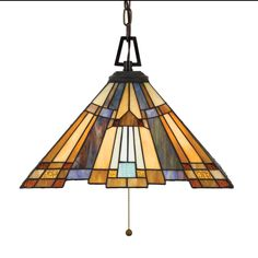 Love craftsman style glass.This Three Light Down Pendant has a Valiant Bronze Finish and Tiffany Glass. A classic geometric Arts  Crafts piece with handcrafted art glass in shades of sapphire blue, warm honey, amber and cream.