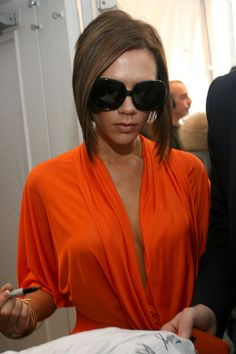 Victoria Beckham Victoria Beckam signs a SVEDKA's e.vil t-shirts for Heal the Bay backstage Mercedes-Benz Fashion Week Fall 2008 at Bryant P...