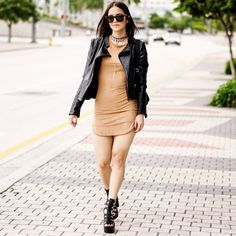 TAN SUEDE MINI DRESS Bring that inspired slip dress to a whole new level. We love this mini dress featured in a camel color. Perfect this look with a pair of tall, black gladiator sandals or knee-high boots and become ready for a night to remember while also looking extra-chic. Pictures are showing a small.   Tan Suede Scoop neck Short Sleeve Round Bottom 92% Polyester 8% Spandex Style Link Miami Dresses Mini