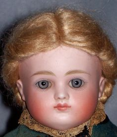Another country auction find. There was nothing left of her original wig, but the remainder of this lovely doll is definitely original layers.  I just love her face. Enlarge the photo to appreciate her wonderful spiraled eyes.