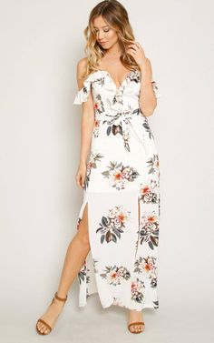 Woven maxi dress featuring a sweetheart bodice with ruffle cold shoulder accents. Two-toned floral print throughout. High slit on front. Unlined. Woven. Lightweight.100% Rayon Machine Wash ColdImported Modeled In Size Small