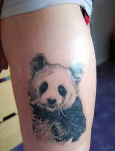 bear tattoo design on foot