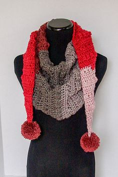 This scarf is a trendy triangular scarf that can be accented with pom poms or tassels. It is the perfect addition to any fall AND winter wardrobe.