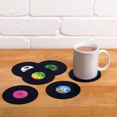 DETAILS - Music always follows you where ever you go! - Maybe it is hiding under your mug! - Add a new spin to your rock and rollin' lifestyle. - Vinyl Record Coasters are great for parties and music