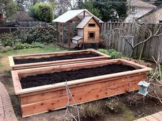 Raised beds with chicken run in the back.