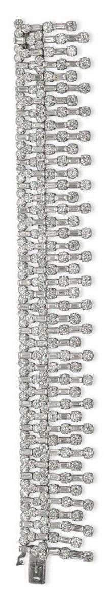 A SET OF DIAMOND 'CASINO' JEWELLERY, BY CARTIER The necklace designed as graduated fringes of alternated brilliant and baguette-cut diamonds, a bracelet and a pair of earrings en suite, mounted in gold, 2005. [Bracelet only]