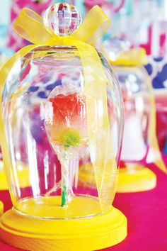 love it - the rose under glass from Beauty and other Princess Party Ideas - site doesn't say where to get the stuff. But I could probably make this with a plastic wine cup turned upside down and a small plastic plate ( and a flower sucker)....