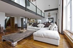 Mesmerizing Open Living Room Design With White Fabric Sofa Cushions White Black Color Wooden Table And Wood Floor Also Dining Space And contemporary Kitchen Space