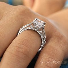 Let the beauty of your heart speak with this stunning 18k white gold, princess-cut diamond engagement ring. The side view displays the overall detailed craftsmanship.  Discover more engagement rings with unique detailing on our page!