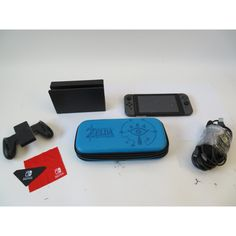 #videogames #Gamers #nintendo switch Nintendo Switch HAC-007 Video Game System w/ Zelda Case 323.18      Item specifics   Condition: Used      :                An item that has been used previously. The item may have some signs of cosmetic...