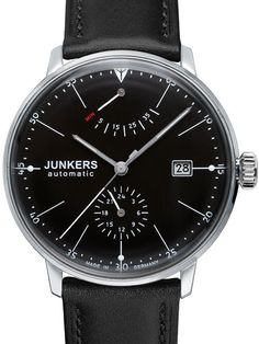 Junkers 6060-2 Bauhaus watch comes with a power reserve meter at 12:00 and a 24 hour sub-dial at 6:00. Inside is a modified 26-jewel Citizen self-winding movement with a silver rotor that is viewable via an exhibition case back. Hesalite crystal.