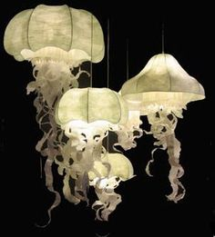 Serene jelly fish chandelier.  Perfect for your zen space!  Check out http://www.customhomesbyjscull.com/ for more custom home ideas!