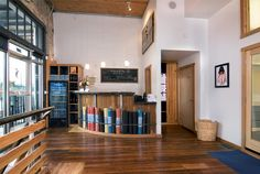 Bikram Yoga Athens Lobby-I like the wood and metal counter, possible with merchandise