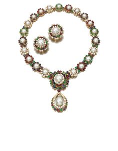 Diamond and gemstone demi-parure by Van Cleef & Arpels. The necklace designed as a series of graduated clusters each set at the centre with a cultured pearl respectively framed with circular-cut rubies, sapphires, emeralds and brilliant-cut diamonds, suspending a detachable pendant similarly set, and a pair of ear clips en suite.