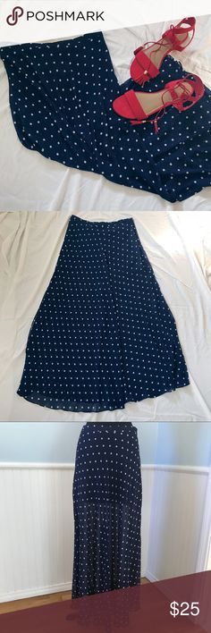 """Navy & White Polka Dot Chiffon Maxi Skirt Size L Navy & White Polka Dot Chiffon Maxi Skirt - Hidden side zipper - About 42"""" long (skirt lining is about 14"""" long) - Measurements (lying flat):  Waist ~ 15"""", Hips ~ 19"""" Tags: spring wedding, summer wedding, retro skirt, races, derby, festival, graduation, bridal, summer, vacation, travel Forever 21 Skirts Maxi"""