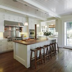 White craftsman kitchen. Love ceiling and island top, bar stools and inset in island.