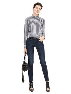 Our easy-fit navy and white striped cotton button down shirt skims your shape for a relaxed (but put-together) silhouette. Tuck this shirt into a pair of skinny jeans, and complete the look with a studded black bag and pointed-toe black booties   Banana Republic