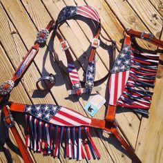 Magics Custom Tack Red white and blue patriotic American flag fringe tack set with matching wither strap and tie down keeper Www.magicscustomtack.com barrel racing rodeo horse riding tack dog cat collars leatherwork mounted shooting