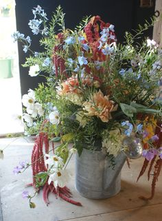 Floral arrangement in a metal watering can. Broadturn Farm. Foster's clambakes and Catering. rustic barn-style weddings and tradtional Maine lobster bakes. http://www.fostersclambake.com