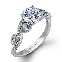 Twist Collection - This gorgeous 18K white engagement ring and band are comprised of .22ctw round white Diamonds, .09ctw marquise cut Diamonds, and .13ctw pear shaped Diamonds.  - MR2336 // also pretty, also needs a marquise center stone