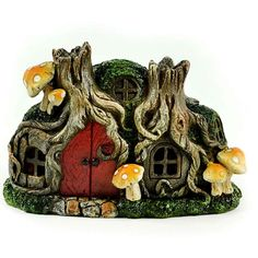 Fairy Homes and Gardens - Miniature LED Tree Stump House, $14.79 (https://www.fairyhomesandgardens.com/miniature-led-tree-stump-house/)