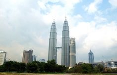 The Petronas Towers, also known as the Petronas Twin Towers are twin skyscrapers in Kuala Lumpur, Malaysia. PETRONAS, short for Petroliam Nasional Berhad, is a Malaysian oil and gas company.