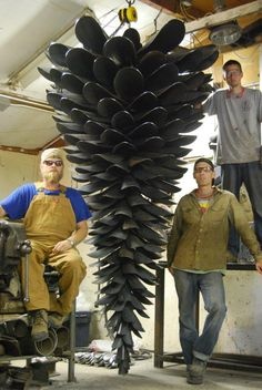 amazing giant fir cone sculpture made from old shovels, by artist Floyd Elzinga... would be beautiful in the garden