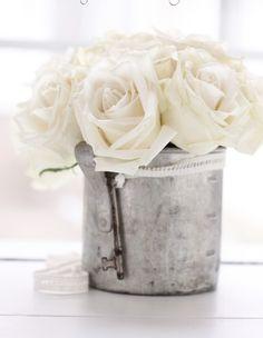 <3 white roses in galvanized tin with skeleton key