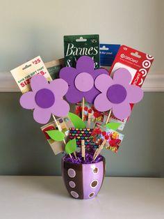 Gift card tree for teacher appreciation. Arrangement of gift cards in flower pot.
