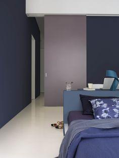 Modern bedroom - white floor - blue - purple - desk - floral bedding // love the colour combination!