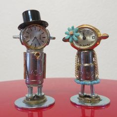 Thirty Seconds is an industrial art couple created from industrial bits and vintage pieces using E 6000 (an industrial strength adhesive). The name is a play on the socket size used to create their bodies and the watches used for their heads. (in case you were wondering!) The groom is 2 1/4 inches tall and the bride is just under 2 inches tall. The are both on 1 inch diameter bases.