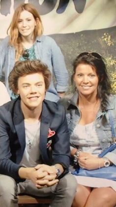 Harry's real sister and mom with the wax model of him.