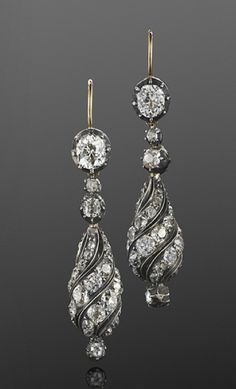 Antique Old Mine Diamond Spiral Pendant Earrings, French, circa 1880  Old mine diamond set spirals with a total of approximately 6.70 carats are suspended from old mine diamonds weighing approximately 1.40 carats in a silver top yellow gold mounting.