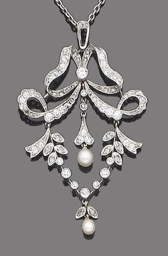 A Belle Époque seed pearl and diamond pendant, circa 1905. The fluttering ribbon bow surmount suspending an articulated foliate garland, millegrain-set throughout with old brilliant, single and rose-cut diamonds, suspending two central seed pearl drops, suspended from a fine trace-link chain.
