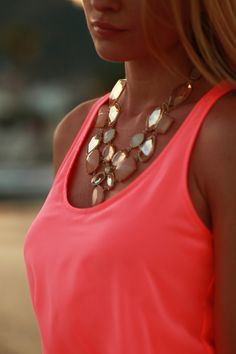 Pair bright tanks with a statement necklace that plays off the color of it. Pieces that are a few shades lighter or darker instantly give dimension to your ensemble!
