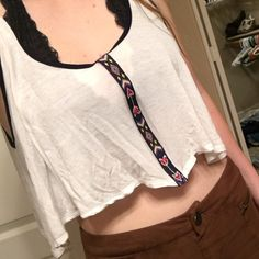 White tank top with knitted detailing Super Cropped sheer white tank top with pretty detailing down the center. Originally from Nordstrom: brand is Elodie. No trades for this! Free People Tops Tank Tops