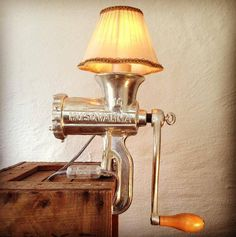Meat Grinder Lamp made from large Husqvarna 10 meat grinder. More industrial lamps and vintage home decor at www.rustyremakes.com.