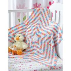 Bernat Star Blanket Free Crochet. Free star shaped crochet baby blanket. Beautiful striped star baby blanket radiates outward in Bernat Baby Coordinates. Free Pattern More Great Looks Like This