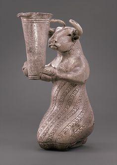 Kneeling Bull Holding a Spouted Vessel  --  Circa 3100-2900 BCE  --  Silver  --  Southwestern Iran  --  Metropolitan Museum of Art