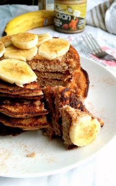 Three Ingredient Paleo Almond Butter Banana Pancakes. Delicious for breakfast and topped with honey!