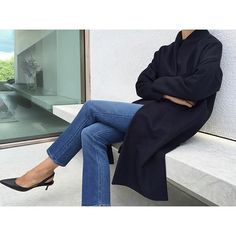 The Chelsea Coat in navy paired with Straight Denim in mid-blue. Available at toteme-nyc.com #toteme