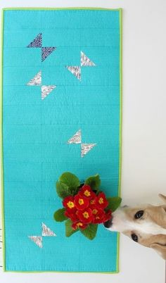 Aquamarine Table Runner Pattern - If you are looking to add a pop of beachy blues to your summer home dcor or just want some cheer year-round, learn how to make this bright and beautiful quilted table runner. Easy to construct and made out of bright blues and greens with hints of black, white, and navy, the Aquamarine Table Runner Pattern will look chic is just about any home on the block.