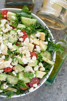 Chopped Kale Salad with tomato, cucumber, avocado, and feta + a yummy homemade dressing!