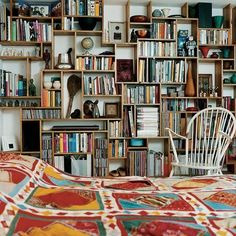 That would be my kind of bedroom. Wall-to ceiling bookshelves.