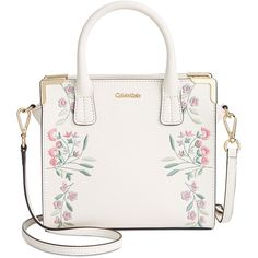 Gleaming hardware shines on a Calvin Klein crossbody satchel embroidered with garden botanicals. The boxy shape gives it a dressy look.
