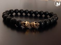 Matte Black Onyx and Gold Skulls Mens Beaded Bracelet by NenoWood